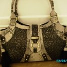 Sharif Suede designer handbag with tooled leather insets