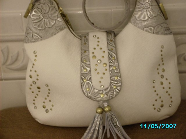 Charm and Luck pebbled leather designer handbag.