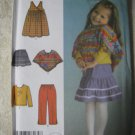 Simplicity 4437 Sizes 1/2 -4 Toddlers' Pants, Skrt, Jumper, Poncho & Knit Top