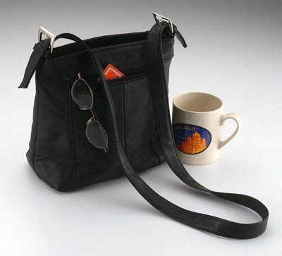 Embassy USA� Genuine Leather Purse with adjustable strap.