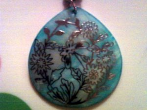 Beautiful Mother of Pearl Pendent with Silver Floral Detail.