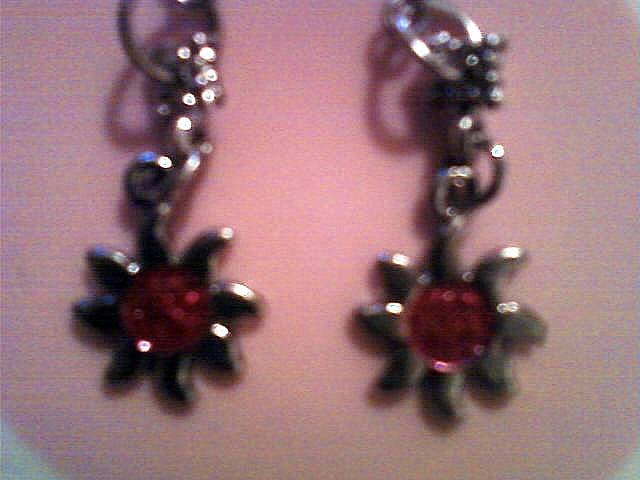 Silver Sun Earrings with Raspberry Pink Sparkle Center.
