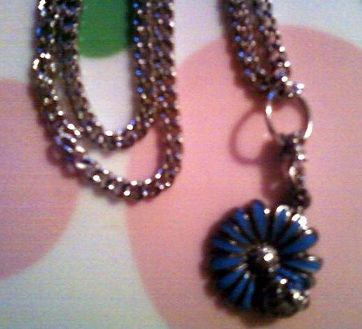 Silver Ladybug on a Blue Flower Necklace.