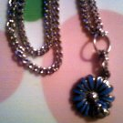Silver Ladybug on a Blue Flower Necklace.