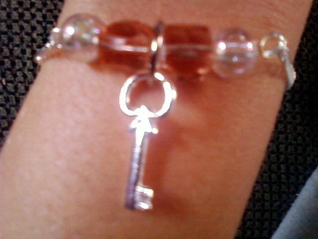 Silver Key and Bead Bracelet.