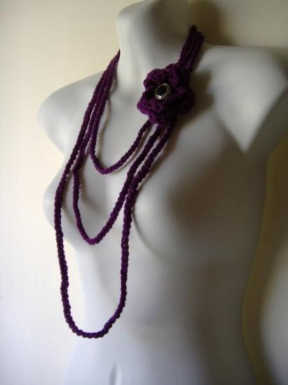 the long flower necklace in eggplant purple.