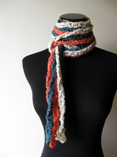 the twisted colors scarf in teal, cream, and mango.
