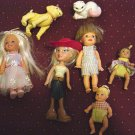 7 Small Dolls Bratz, Little Boy, Communion Girl, 2 Athletic Girls, Two Babies, Dog and Cat  #600196