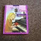2007 Our Generation Hardback Book Entitled The Note in the Piano by Julie Driscoll #600317