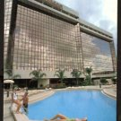 ca 1984 POSTCARD RADISSON MART PLAZA HOTEL MIAMI FLORIDA WITH LADIES LOUNGING BY THE POOL