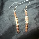 earrings made with round wood beads and beads shaped like fish