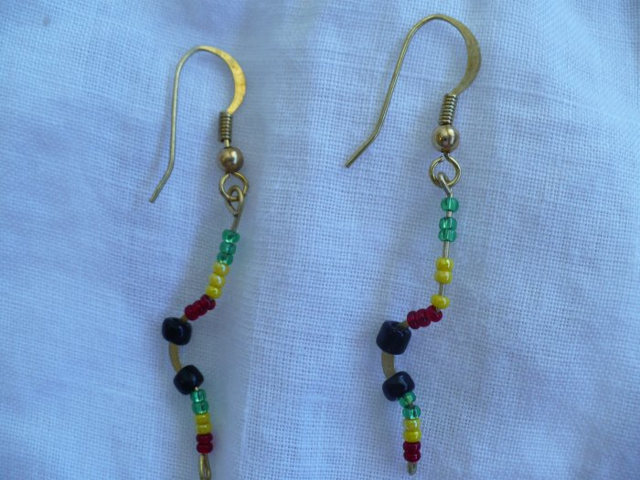 gold plated earrings with red,yellow green and black beads.