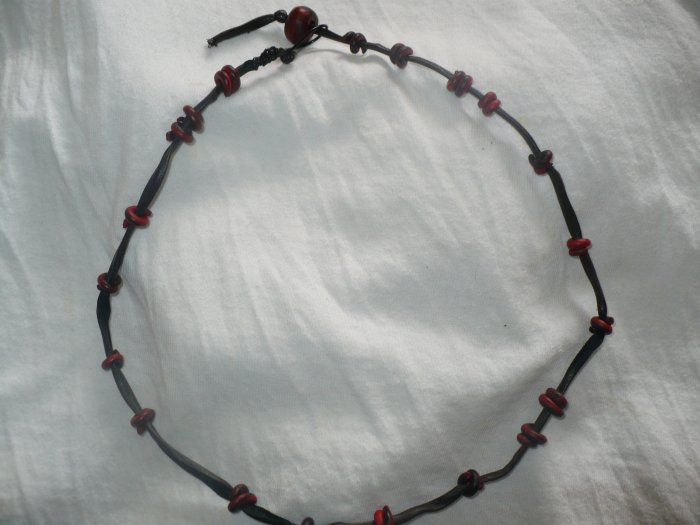 black and red necklace made with cloth and polymer