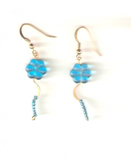 earrings made with turqoise blue flower shaped beads and turqoise blue seed beads