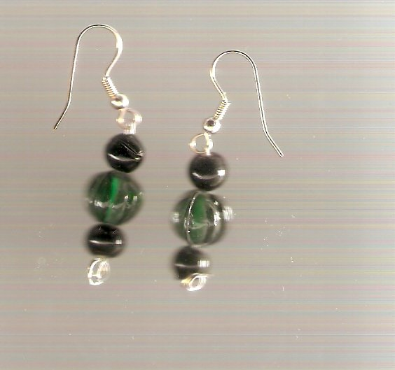 earrings made with green and black beads