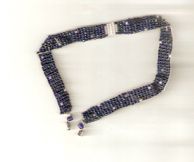 Dark blue beaded choker with white accents inspired by the night sky.