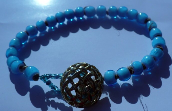 Large bracelet made of turqoise glass beads