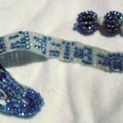 "blue  beaded bracelet spells out ""peace""in white letters."