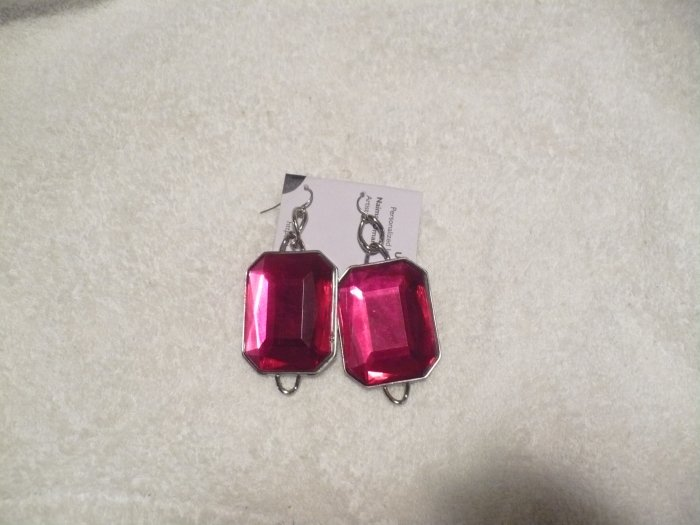 earrings made with fuscia colored glass