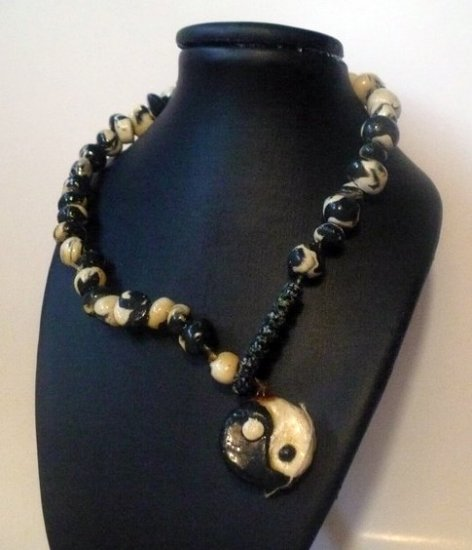 Yin -Yang necklace made of black and white polymer clay