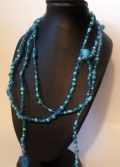 long necklace made with turquose colored glass beads