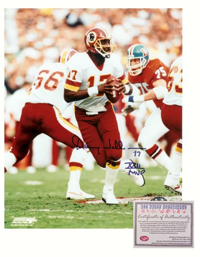 Signed Doug Williams Photo - 8x10 Dropping Back Super Bowl XXII MVP