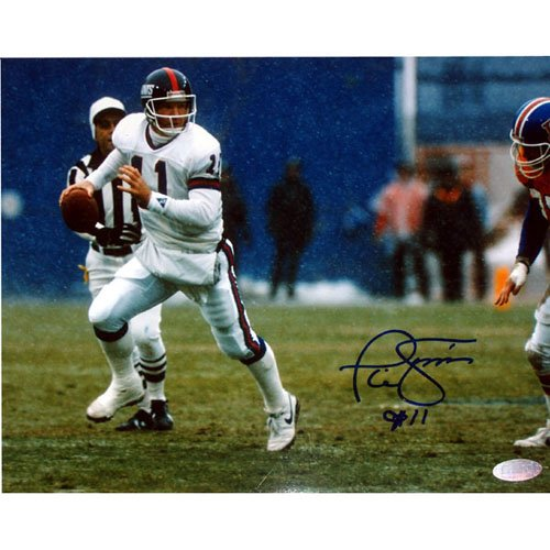 Phil Simms Signed Photo - 8x10 Passing In Snow Vs. Denver in Blue Ink
