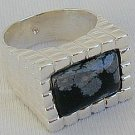 A black flakes ring