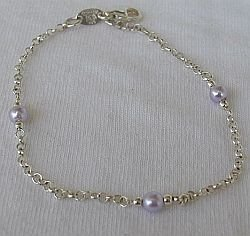 Silver bracelet with purple beads