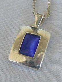 Mini blue cat eye pendant