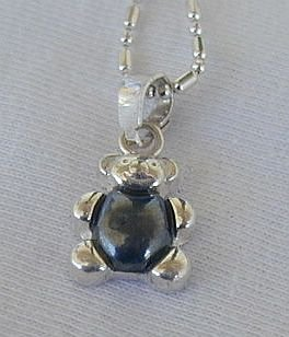 Teddy bear pendant.