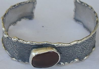 Reddish silver bangle