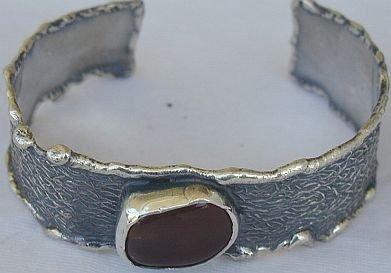 Reddish silver bangle