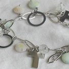 Quartz and silver crosses bracelet