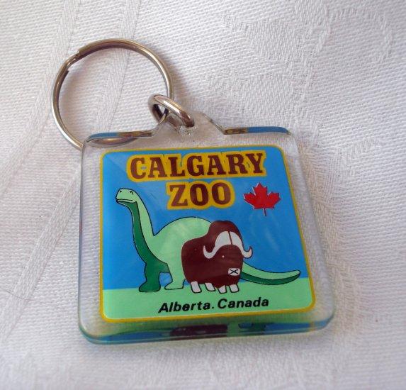 Calgary Zoo Alberta Canada souvenir key chain plastic dinosaur water buffalo 1146vf