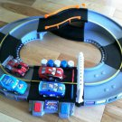 USED Fisher Price Shake 'n Go Speedway includes 3 Nascar Vehicles & 1 Pixar Cars King Vehicle Racer