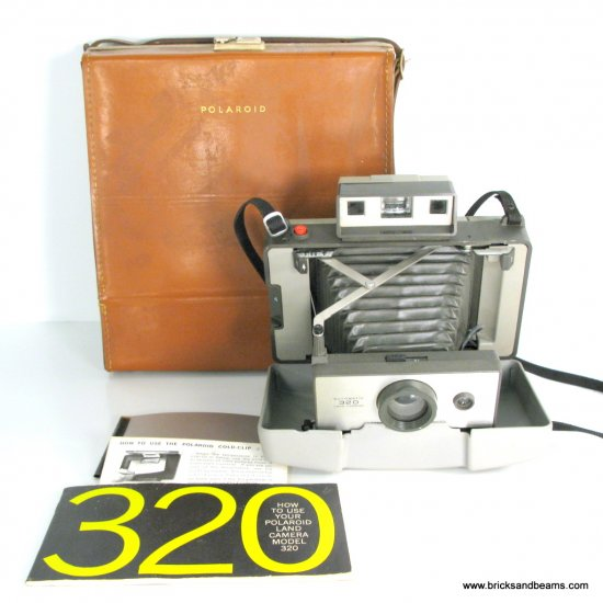 Vintage Polaroid Land Camera Automatic 320 Folding Camera with Leather Case and Manual