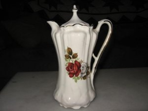 Antique Pitcher with Lid
