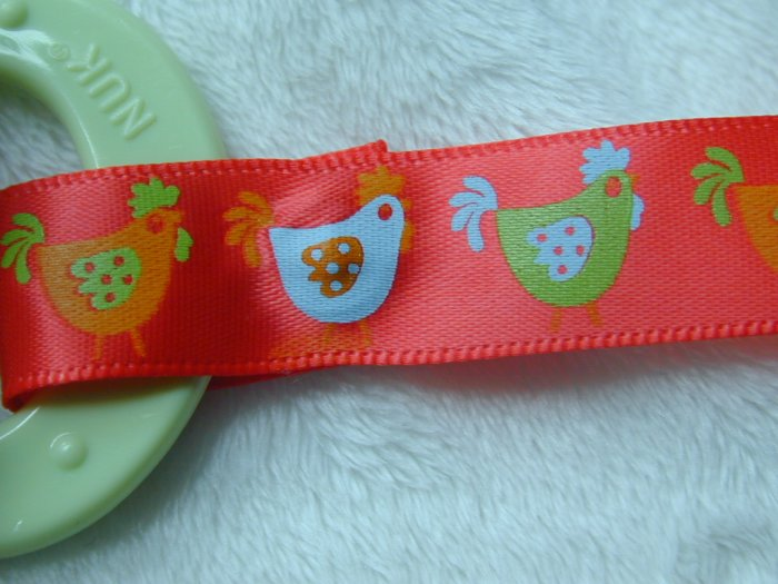 Red chicken binky clip