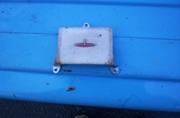 1964 Oldsmobile dash emblem clock filler panel