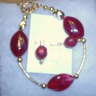 Ruby Red stones with gold spacers and earrings