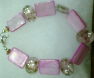 clear stone with pink flowers on it....