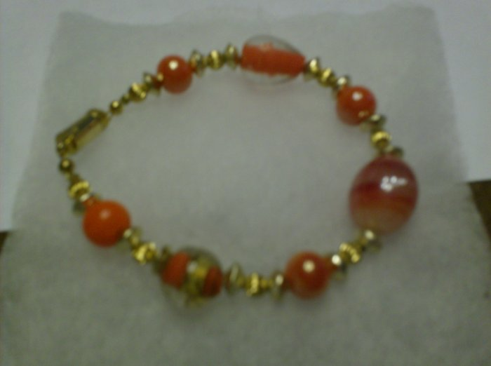 Orange/white bead mixture glass bracelet