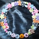 Kids bracelet made with flowers & butterflies! Adjustable custom names or phrases! Memory wire