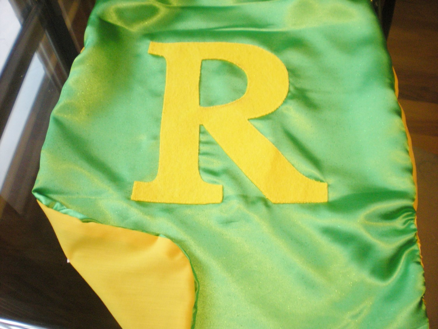 Green Cape with no shield and Large Initial
