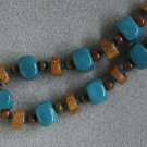 """Wood-Teal"" necklace with wood, ceramic, Czech glass and tiger iron beads and copper"