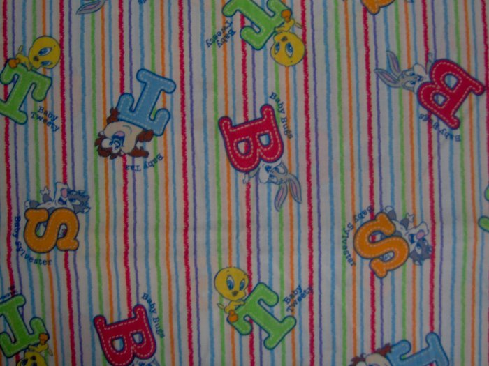 Warner bros baby looney tunes character toss on stripes for Kids character fabric