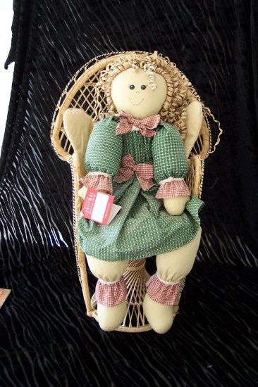 Doll in Wicker Chair
