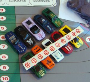 Die cast race cars & red # stickers (3-10)