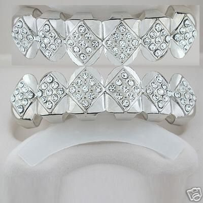 Fifty-Four points of ice silver playa top and bottom grillz set